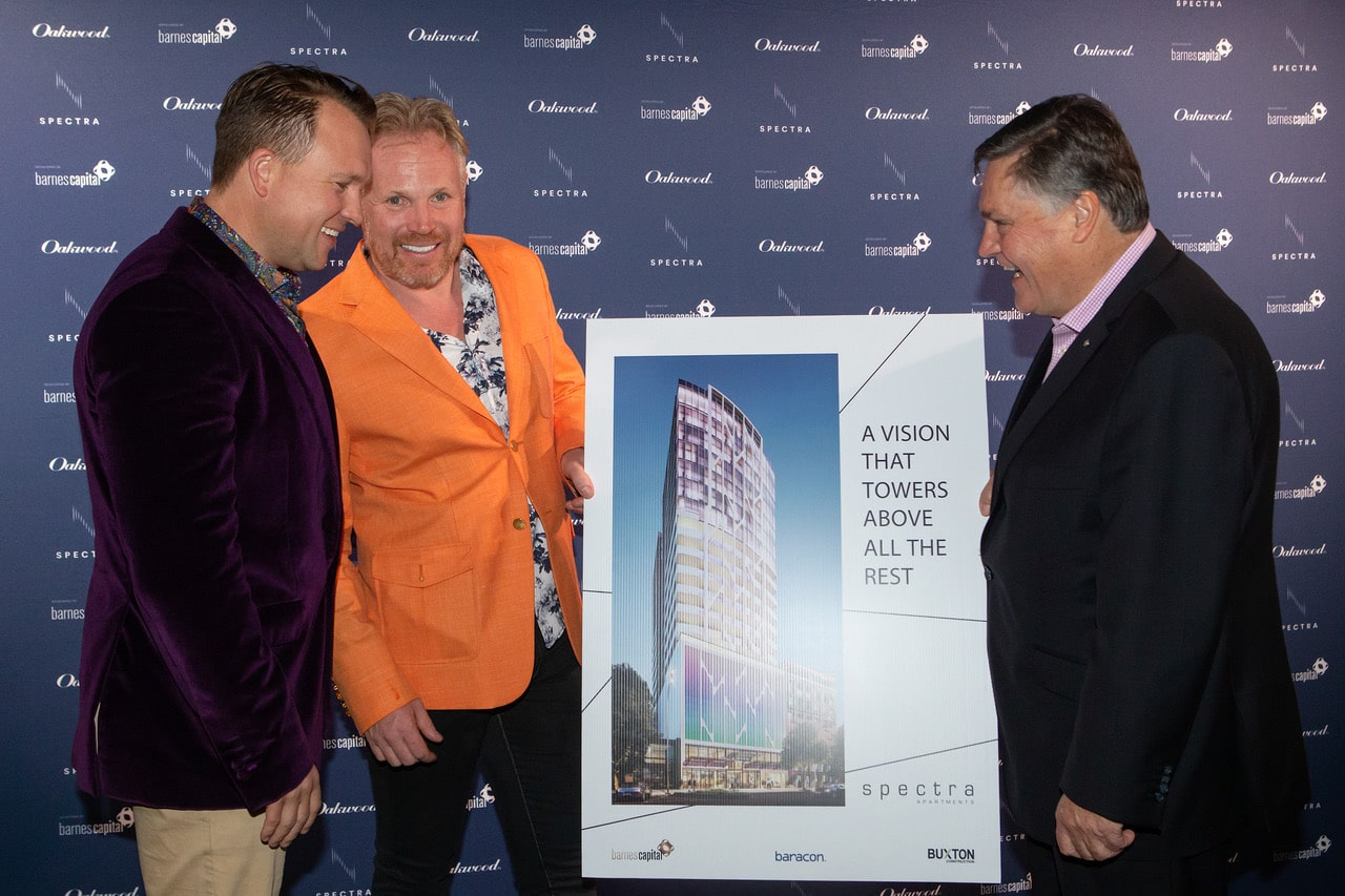 Men holding image of a building